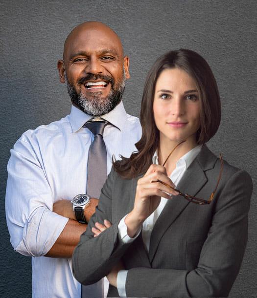 Businessman and businesswoman power posing
