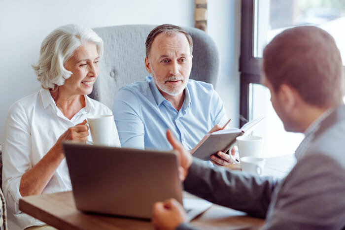 couple going over information with insurance agent